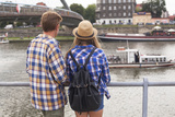 Young Couple on the River Bank in a European City (Rear View) Romantic Journey. Photographic Print by De Visu