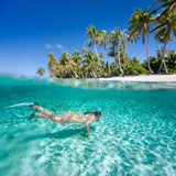Woman Swimming in a Clear Tropical Waters in Front of Exotic Island Photographic Print by BlueOrange Studio