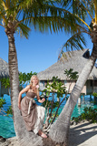 The Beautiful Woman with a Rose at a Palm Tree. Bora-Bora Tahiti Photographic Print by  Konstik