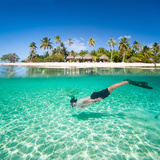Man Swimming in a Tropical Lagoon in Front of Exotic Island Photographic Print by BlueOrange Studio