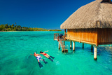 Young Couple Snorkeling from Hut over Blue Tropical Lagoon Photographic Print by Martin Valigursky