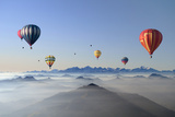 Hot Air Balloons over Mountain Skyline Photographic Print by Axel Lauerer
