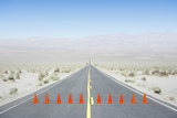 Long Road with Caution Cones across Road. Photographic Print by Thomas Northcut