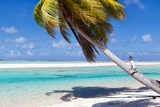 Little Boy Sitting on Palm at Exotic Beach Photographic Print by BlueOrange Studio