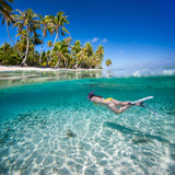 Woman Swimming Underwater in Clear Tropical Waters in Front of Exotic Island Photographic Print by BlueOrange Studio