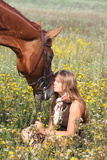 Girl Sitting on the Ground and Chestnut Horse Standing Near Photographic Print by Anastasija Popova