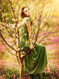 Fairy-Tail Forest Nymph, Beautiful Sexy Woman at Spring Garden, Wearing Long Dress, Sitting on Bloo Prints by Anna Omelchenko