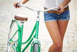 Close-Up of Young Woman with Bicycle Photographic Print by  pressmaster