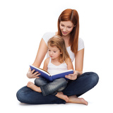 Childhood, Parenting and Relationship Concept - Happy Mother with Adorable Little Girl Reading Book Photographic Print by  dolgachov