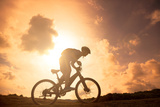 The Silhouette of Mountain Bicycle Rider on the Hill Photographic Print by Tom Wang