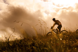 Happy Couple Riding Bicycles Outside, Healthy Lifestyle Fun Concept. Silhouette at Sunset Panoramic Photographic Print by  warrengoldswain