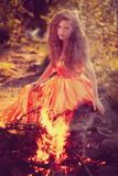 Beautiful Witch in the Woods near the Fire. Magic Woman Celebrating Halloween. Girl Doing Witchcraf Photographic Print by  Miramiska