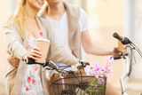 Summer Holidays, Bikes, Love, Relationship and Dating Concept - Closeup of Couple Holding Coffee An Photographic Print by  dolgachov