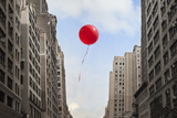Red Balloon Floating through City Photographic Print by Thomas Jackson