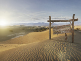 Disconnect Wooden Sign in the Desert Photographic Print by Miguel Navarro