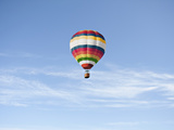 Hot Air Ballon against Blue Sky Photographic Print by Luxx Images