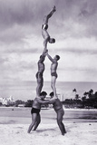 MEN AND GIRL PERFORM ACROBATICS ON BEACH Photographic Print by Archive Holdings Inc.