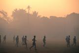 Children Playing Soccer at Sunset, Tha Khaek, Khammuan, Laos, South-East Asia Fotografisk tryk af John Elk III
