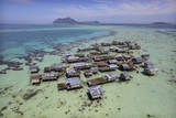 Floating Village on a Coral Reef in Celebes Sea Photographic Print by Timothy Allen