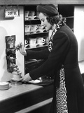 Woman Getting Coffee at Old Fashioned Machine Papier Photo par George Marks
