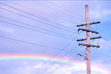 Powerlines against Rainbow Sky Photographic Print by Nikki Yetman
