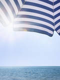 Beach Umbrella and Seascape with Sun Flares Photographic Print by Gregor Schuster