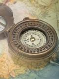 Compass with Transparent Map Fotografisk tryk af Andrew Unangst