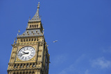 England, London, Big Ben, Aeroplane Flying in Blue Sky in Background Photographic Print by Michael Blann