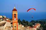 Paraglider Soaring past Tower of Colourful Village Church, Alpes-Maritimes, Roquebrune, Provence-Al Photographic Print by David Tomlinson