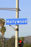 Close-Up of a Blue Street Sign on a Lamppost for Hollywood. Photographic Print by  Thinkstock