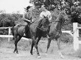 Couple Horseback Riding Photographic Print by George Marks