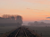 Misty Morning Sunrise by Single Railway Track Photographic Print by Simon Stanley