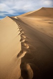 Footprints on Sand Dunes Photographic Print by Tom Grubbe