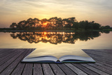 Creative Concept Image of Refelcted Lake Sunset Coming out of Pages in Magical Book Photographic Print by  Veneratio