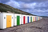 Row of Colorful Beach Huts Receding into Distance on Empty Beach during Dramatic Sunset Prints by  Veneratio
