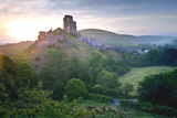Romantic Fantasy Magical Castle Ruins against Stunning Vibrant Sunrise Photographic Print by  Veneratio