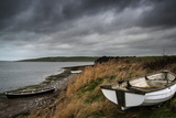 Old Decayed Rowing Boats on Shore of Lake with Stormy Sky Overhead Posters by  Veneratio