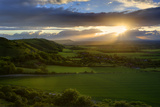 Stunning Countryside Landscape with Sun Lighting Side of Hills at Sunset Posters by  Veneratio