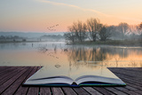 Book Concept Landscape of Lake in Mist with Sun Glow at Sunrise Photographic Print by  Veneratio