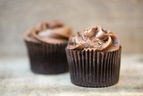 Frosted Chocolate Cupcakes on Rustic Wooden Background Poster by  Veneratio