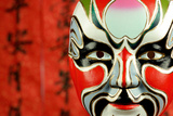 Beijing Opera Masks on a Festive Background. Photographic Print by Liang Zhang