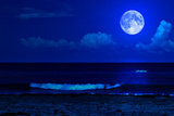 Midnight Sea Landscape with a Full Moon and Waves Breaking on the Beach Photographic Print by  Kamira