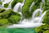 Natural Spring Waterfall Surrounded by Moss and Lush Foliage. Photographic Print by Liang Zhang