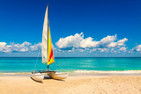 Sailing Boat on a Beautiful Summer Day at Beach in Cuba Photographic Print by  Kamira