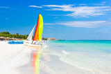 Scene with Sailing Boat at the Famous Varadero Beach , Caribbean Sea in Cuba Photographic Print by  Kamira
