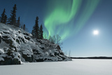 Aurora over Small Snow Covered Hill Photographic Print by Michael Ericsson
