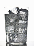 Glass of Ice Cubes in Fizzy Drink Reproduction photographique par Walter Zerla