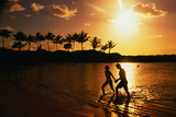 Couple on Beach at Sunset. Photographic Print by Linda Ching