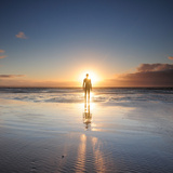 Man Walking on Beach at Sunset Photographic Print by Stu Meech