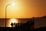 People on the Pier at Sunset, Hokianga Harbour. Photographic Print by Holger Leue